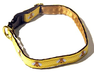 "Although most recognized as the emblem of Napoleon Bonaparte, these tenacious bees have been a symbol of royal power since the ancient Egyptians. This dog collar features realistic bees on a yellow honey comb background, suitable for a dog of royal stature.Available in 5/8"" or 3/4"" widths in Standard, Single Loop or Martingale Dog Collars"