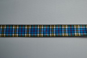 "Clan Thomson's motto is ""For one's country"".  This dress blue tartan is the most commonly seen of the Thomson tartans.  It is a blue, yellow, white, and red tartan.  Available in 1"", or 1.5"" wide collars"